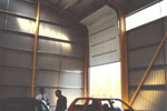 Inside of the refuse sorting building, showing the mechanism for the large vehicle doors